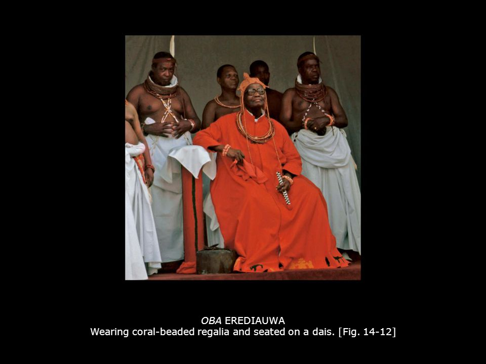 OBA EREDIAUWA Wearing coral-beaded regalia and seated on a dais. [Fig